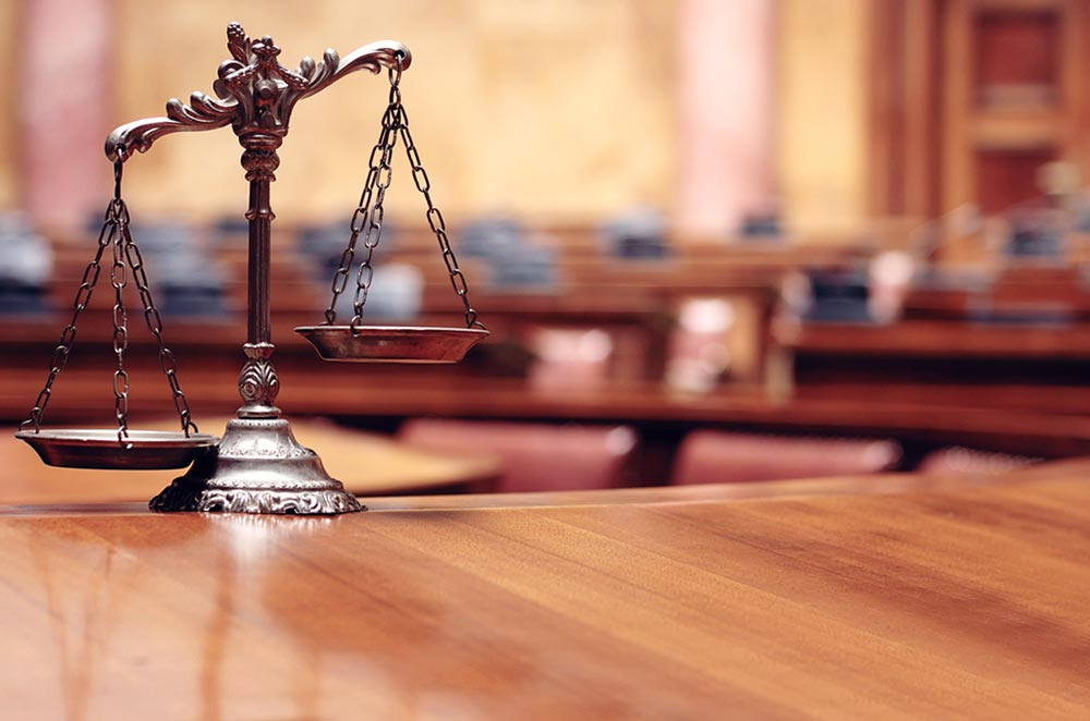 legal scales on a wooden desk