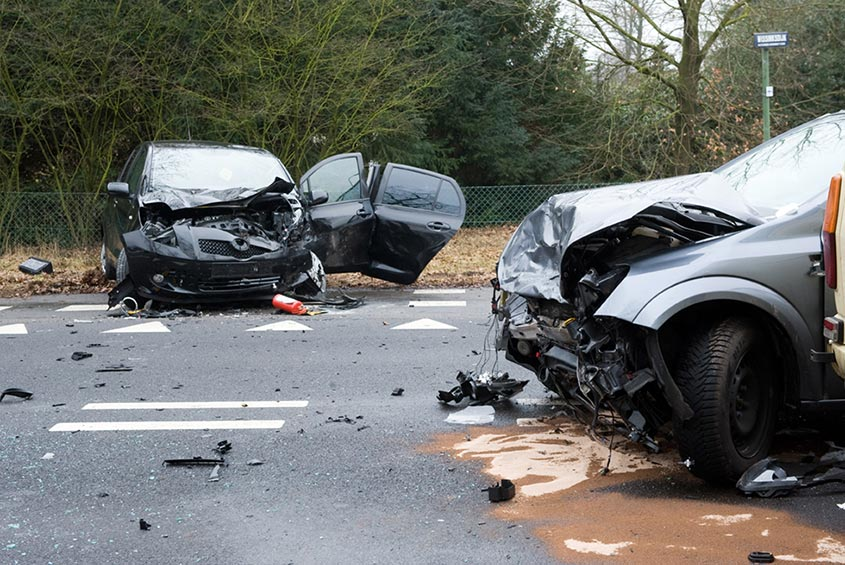 car crash with two heavily damaged vehicles